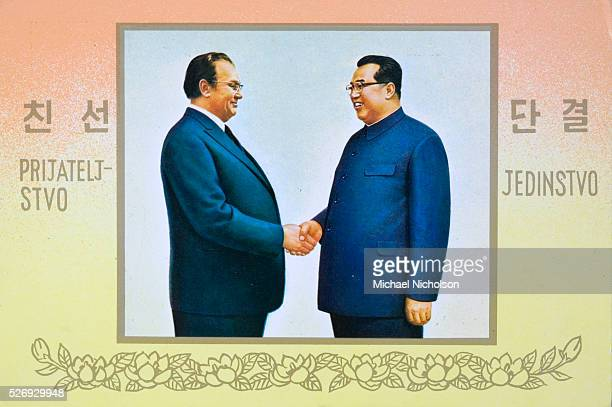 Postcard celebrating a meeting between Marshall Josip Broz Tito of Yugoslavia and Kim il Sung of North Korea The slogans in Serbocroat and Korean say...