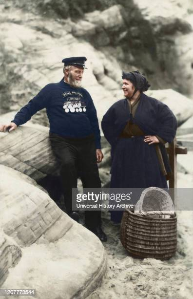 Postcard circa 1900 Victorian/Edwardian Social History Lifeboat Coxwain Robert Scraper Smith with his daughter on Cullercoats beach The Medals on his...