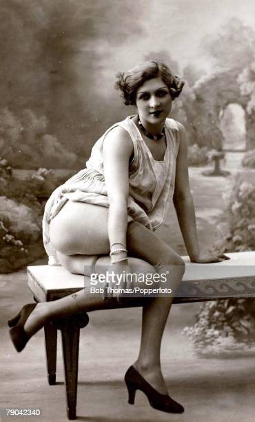 Postcard circa 1920 Dishabille Blond haired woman with her dress pulled up exposing her bottom