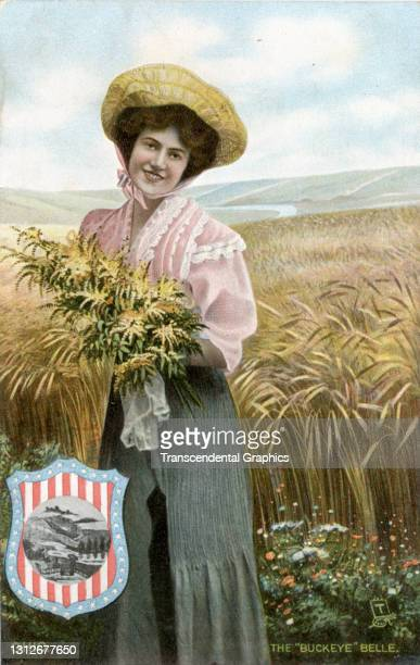 Postcard features an illustration of a young woman as she poses with a bouquet of flowers, circa 1910. The postcard is part of series in which each...
