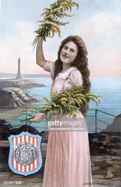 Postcard features an illustration of a young woman as she poses with an armload of flowers, circa 1910. The postcard is part of series in which each...