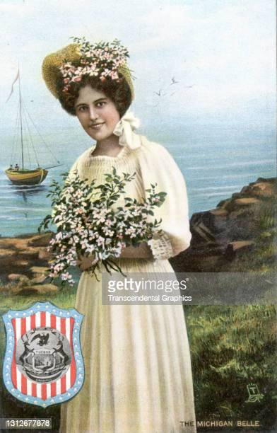 Postcard features an illustration of a young woman she poses with a bouquet of flowers, circa 1910. The postcard is part of series in which each...