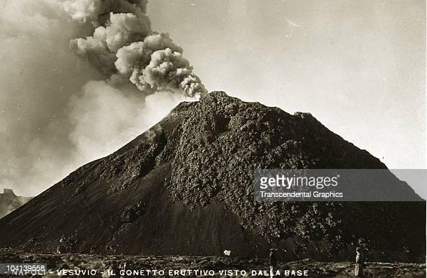 A postcard featuring a view of a smoking Mt Vesuvius with onlookers visible near Naples Italy 1920