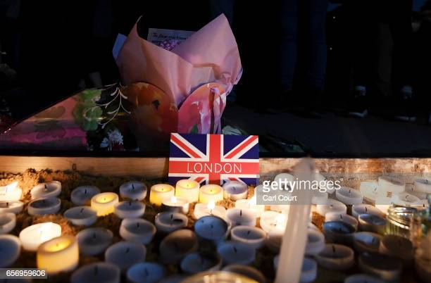 A postcard is left amongst candles during a candlelit vigil at Trafalgar Square on March 23 2017 in London England Four People were killed in...
