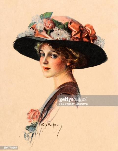 Postcard of a young woman entitled The Favorite Flower, the woman wears a burgundy dress fastened at the neckline with a rose and a large, wide...