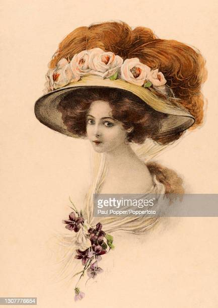 Postcard of a young woman from the 'A Dream of Fair Women' collection by Raphael Tuck, she wears a low cut white dress, and a large, wide brimmed hat...