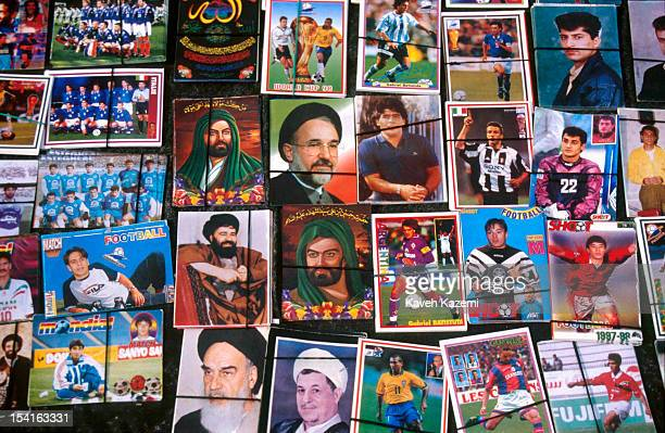 Postcard of Iranian President Mohammad Khatami on display, along with other political, religious and football celebrities, in the window of a...