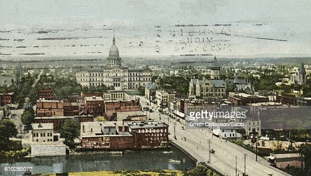 Postcard of the cityscape as seen from an elevated view Lansing Michigan 1914 From the New York Public Library