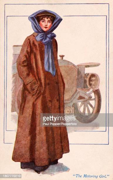 Postcard of The Motoring Girl from The Sports Girls series by James Henderson, a young woman is shown in front of a motor car wearing a full length...
