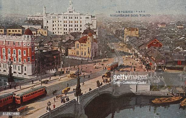 Postcard picture of an old Japanese business district Nihonbashi showing the Nihonbashi bridge which links two sides of the Nihonbashi River with...