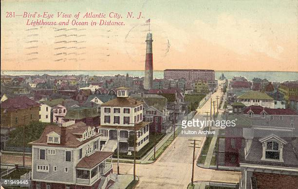 Postcard shows a view of a residential district and lighthouse in Atlantic City New Jersey 191 The caption at the top reads '281Bird'sEye View of...