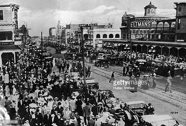 Postcard view of Surf Avenue Coney Island Brooklyn New York circa 1910 The view looks east with Feltman's restaurant and resort in its original...