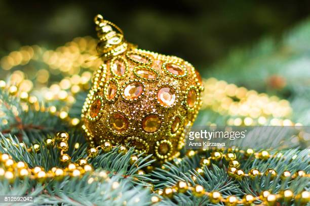 Postcard with christmas tree and decoration on a wooden table, selective focus