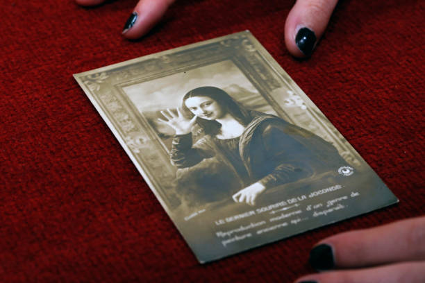 FRA: A Postcard Representing Mona Lisa Written By Paul Eluard To Rene Magritte Goes To Auction At Hotel Drouot