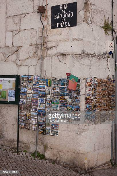 Postcards are displayed on racks on Rua de Sao Joao da Praca a corner in the medieval district of Alfama on 11th July in Lisbon Portugal The national...