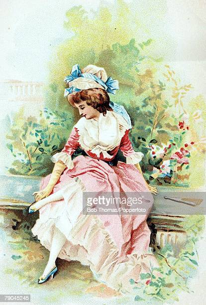Postcards Circa 1915 A colour illustration of a lady wearing a smart pink fashionable dress whilst sitting on a bench in a garden