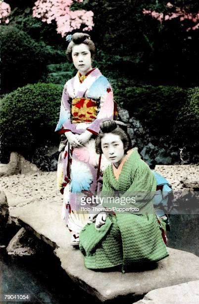 Postcards Circa 1915 A picture of the Japanese girl OKotoSan dressed in authentic robes with her friend in a garden