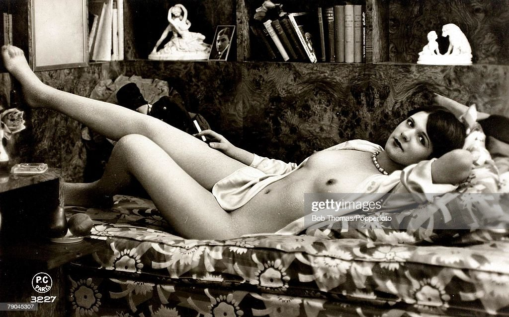 Postcards. Circa 1915. Dishabille. A picture of a partially naked woman lying posing for the camera. : News Photo