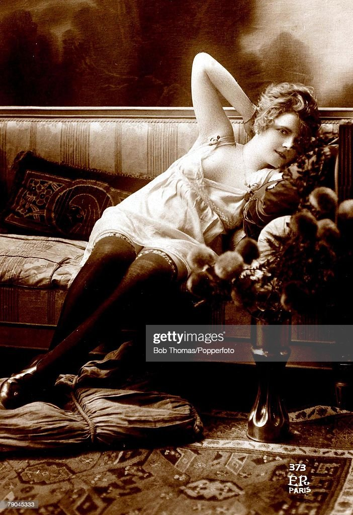 Postcards. Circa 1915. Dishabille. A picture of a scantly clad woman sitting posing for the camera. : News Photo