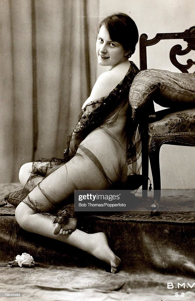 Postcards. Circa 1915. Dishabille. A picture of a woman wearing a black see through wrap whilst sitting posing for the camera. : News Photo