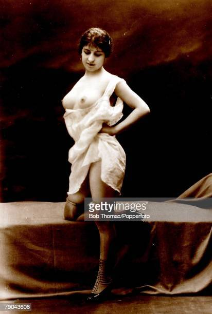 Postcards Circa 1915 Dishabille A picture of a woman wearing a light undergarment whilst revealing her breasts posing for the camera