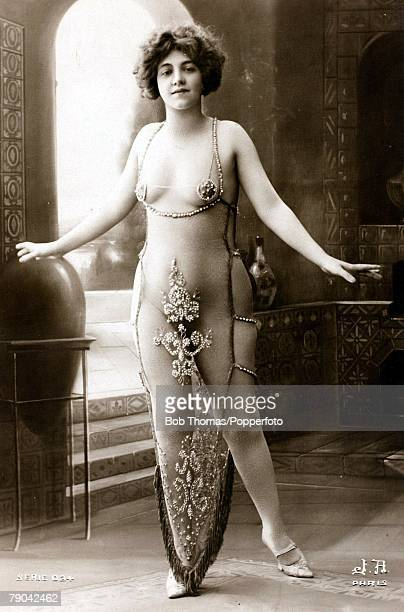 Postcards Circa 1915 Dishabille A picture of a woman wearing a very revealing see through dress posing for the camera