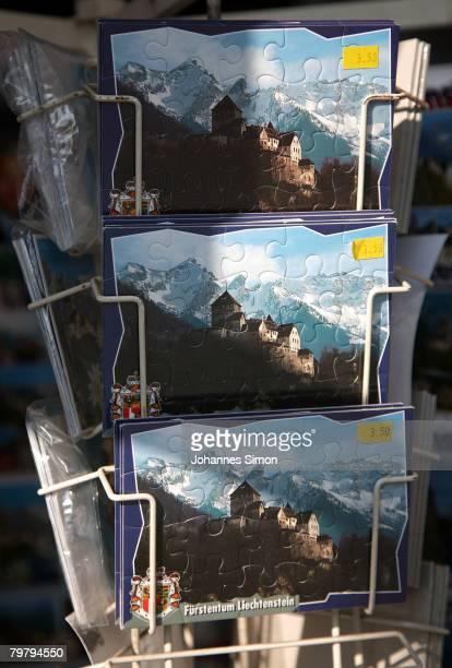 Postcards depicting Liechtenstein Castle home of the Princes of Liechtenstein are displayed in a souvenir shop on February 16 2008 in Vaduz...