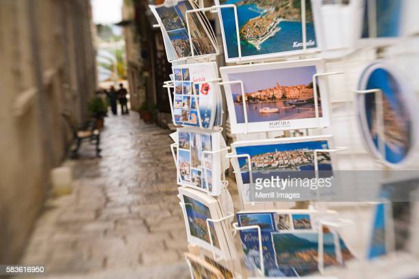 postcards for sale on narrow street in korcula - postcard stock pictures, royalty-free photos & images
