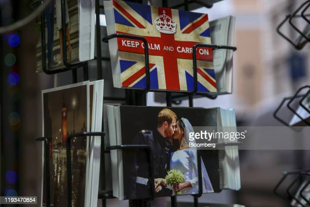 Postcards, including a commemorative design featuring Prince Harry, and American actress wife,Meghan Markle, on their wedding day stand for sale in...