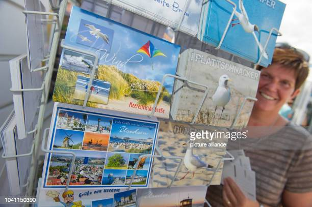 Postcards on sale in Zinnowitz, Germany, 4 August 2016. Although the postcard is not used as evidence for the beauty of the holiday resort anymore,...