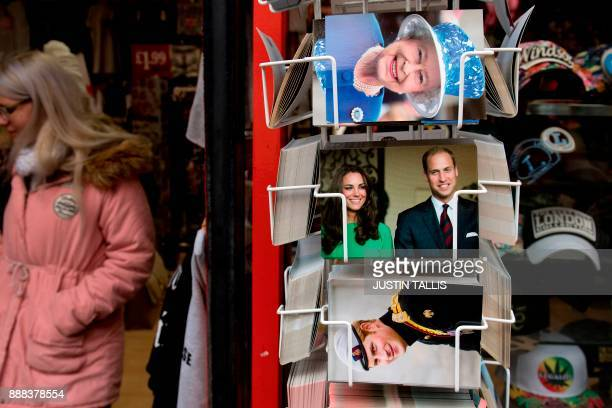 Postcards showing Britain's Queen Elizabeth II and other members of the Royal Family are displayed outside a gift shop in Windsor west of London on...