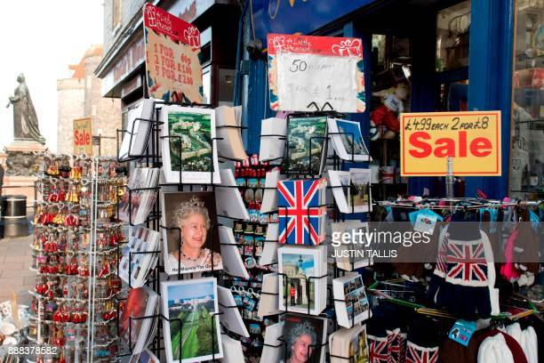 Postcards showing Britain's Queen Elizabeth II and other royal scenes are displayed outside a gift shop in Windsor west of London on December 8 2017...