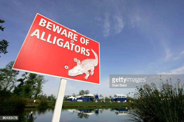Posted sign warns of alligators on the course during the completion of the third round of the Zurich Classic of New Orleans at TPC Louisiana on March...