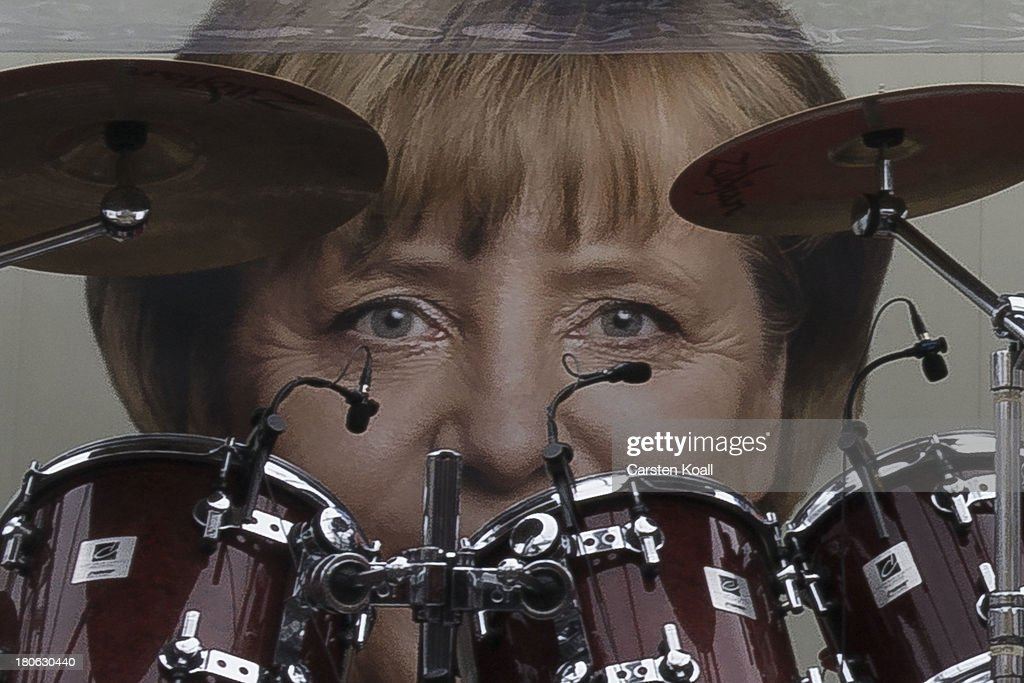 A poster 0f German Chancellor and Chairwoman of the German Christian Democrats (CDU) Angela Merkel is seen behind a drum kit during a CDU election campaign rally on September 15, 2013 in Dresden, Germany. Merkel has a strong lead over her political rivals and the CDU is expected to win federal elections scheduled for September 22