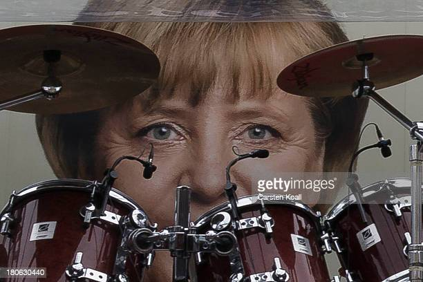 A poster 0f German Chancellor and Chairwoman of the German Christian Democrats Angela Merkel is seen behind a drum kit during a CDU election campaign...