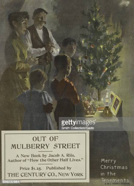 Poster advertisement for a book titled Out of Mulberry Street by Jacob A Rils which depicts a family with a small Christmas tree 1903 From the New...