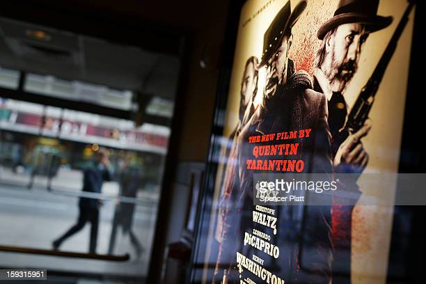 A poster advertises a new film by Quentin Tarantino which has been criticized for excessive violence at a movie theater on January 11 2013 in New...