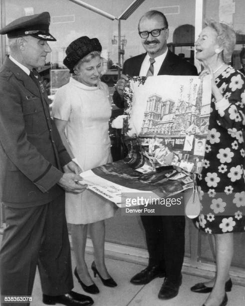 Poster Advertises Grand Prize of Kidney Foundation's Benefit From left are Col Robert Fish Lowry Air Force Base deputy commander Mrs Fish Randall A...
