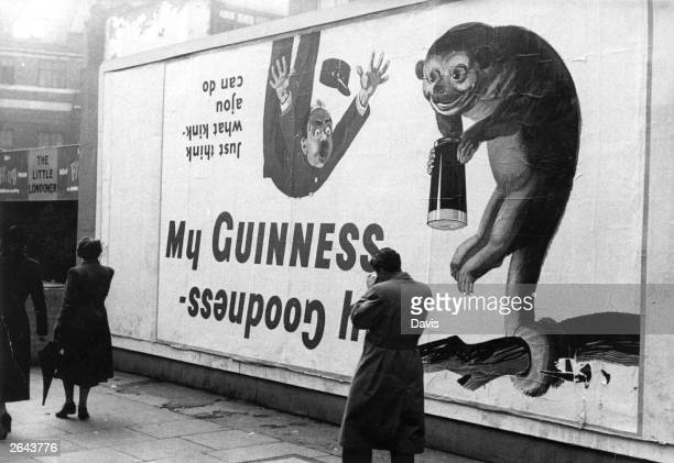 A poster advertising Guinness beer in England Original Publication Picture Post 6201 Starting Post Parade pub 1952