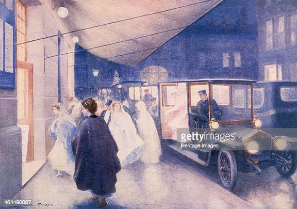 Poster advertising RollsRoyce cars from a catalogue c1907 Evening scene with people arriving at a theatre A woman steps out of a chauffeurdriven...