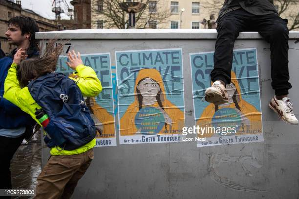 A poster advertising the event is seen as supporters attempt to catch a glimpse of Swedish environmentalist Greta Thunberg as she joins demonstrators...