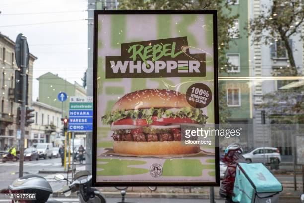 A poster advertising the meatfree Rebel Whopper burger is displayed on a window at a Burger King Holdings Inc fastfood restaurant in Milan Italy on...