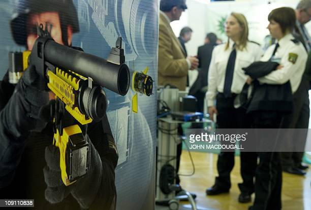 A poster advertising the Taser X12 shot gun which can deliver the Taser XREP electronic control device by arms manufacturer Mossberg is seen at the...