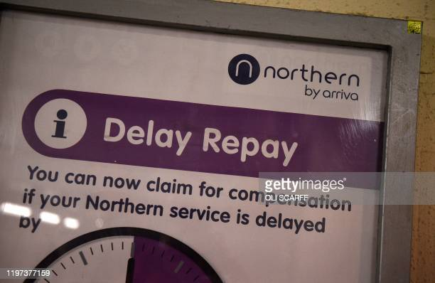 A poster advises rail passengers of their ability to claim compensation for delayed train journeys on Northern trains operated by Arriva a unit of...