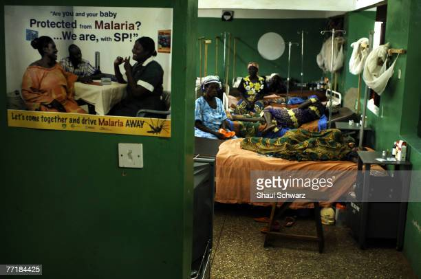 A poster advising of malaria protection is hanged outside the hospital where many infected children are treated September 18 2007 in the Kintampo...