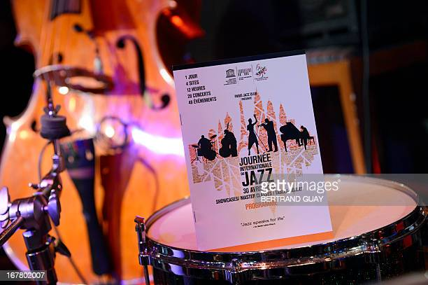 A poster announces the shows in Paris on April 30 2013 in the Duc des Lombards cabaret as part of the Jazz international day AFP PHOTO BERTRAND GUAY