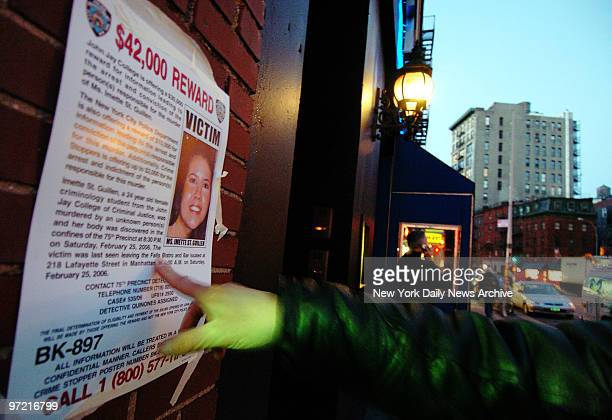 A poster announcing a $42000 reward for information leading to the murderer of Imette St Guillen is taped to the wall outside The Falls bar on...