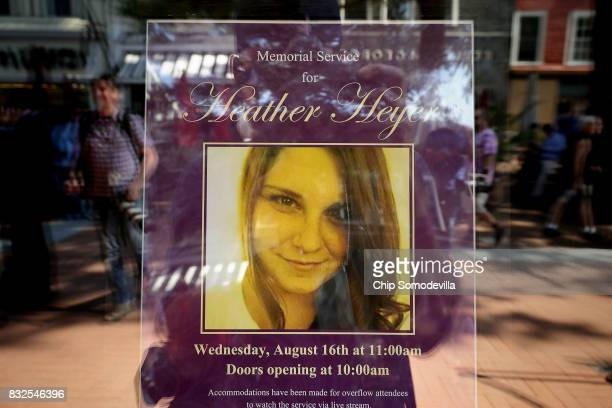 A poster announcing the memorial service for Heather Heyer who was killed when a car slammed into a crowd of people protesting against a white...
