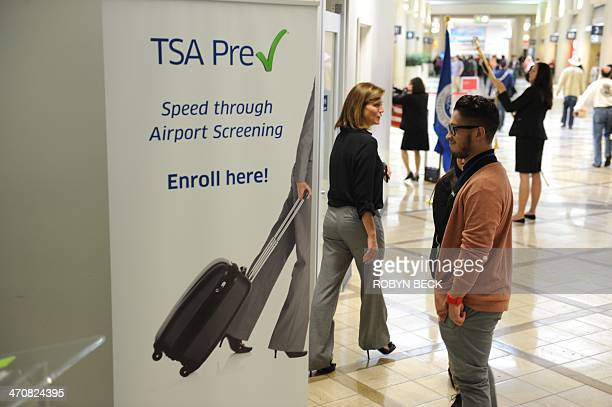 A poster announcing the Transportation Security Administration's new Precheck program is seen outside the PreCheck enrollment office at Los Angeles...