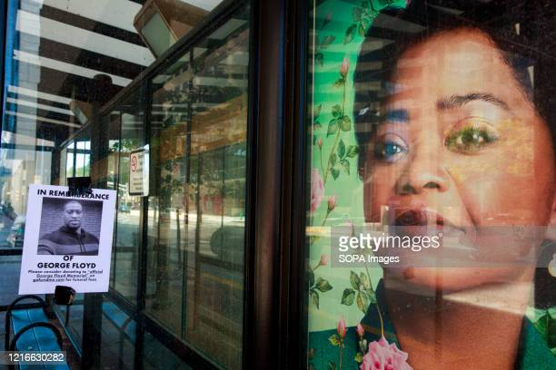 Poster asking for donations for George Floyd's family is next to a photo of a woman playing Madam CJ Walker on television at a bus station in...